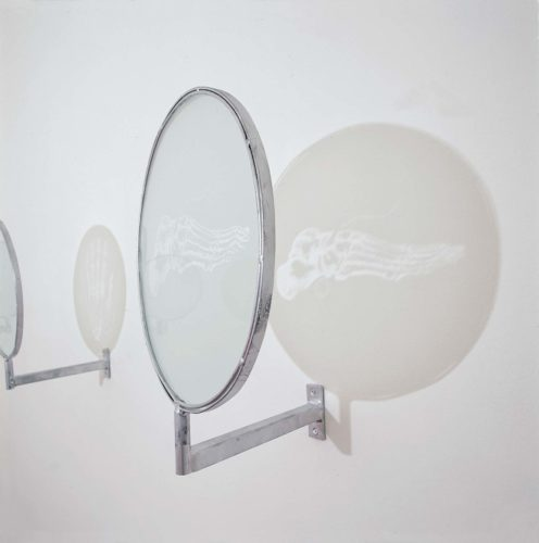sandblasted image on round glass in metal frame