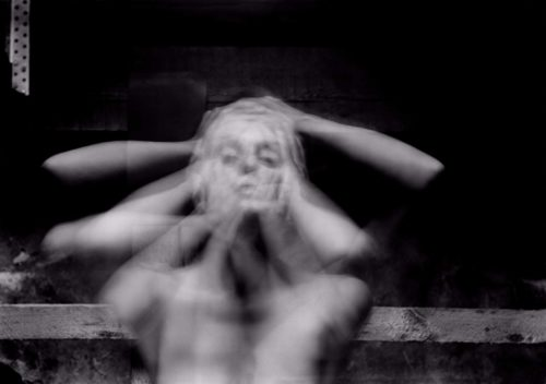 multi-exposure photograph of a face with hands holding head, b/w photograph