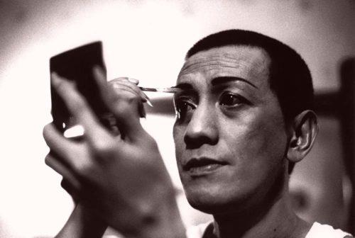 man putting on make-up