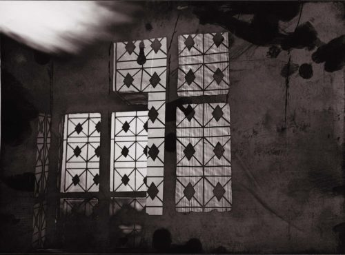 photograph of window and window shadow in sepia colours